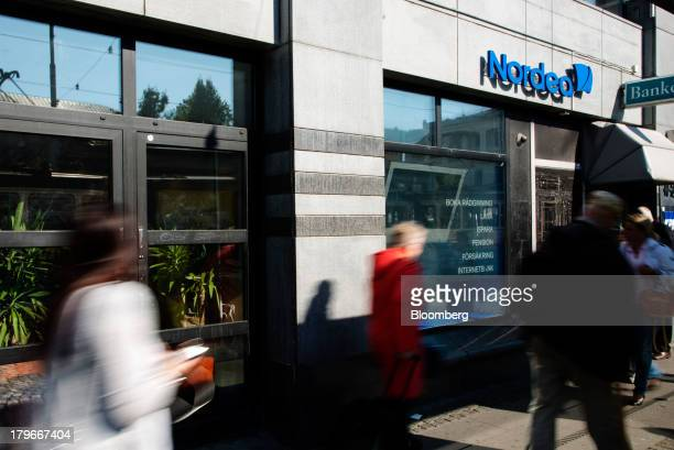 Pedestrians pass a Nordea Bank AB branch in Gothenburg Sweden on Friday Sept 6 2013 Scandinavia's biggest banks have failed to curb funding risks...