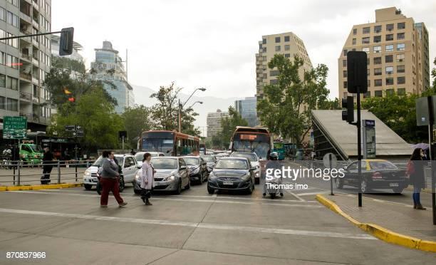 Pedestrians pass a pedestrian light Street scene in Santiago de Chile on October 16 2017 in Santiago de Chile Chile