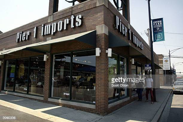Pedestrians pass a Pier 1 Imports store June 17 2003 in Chicago Illinois The home furnishings chain posted lower quarterly profits as poor spring...
