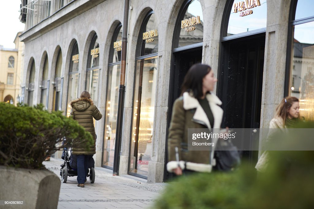 Pedestrians pass a Prada SpA luxury clothing store in Munich, Germany, on Tuesday, Jan. 9, 2018. The German economy's solid 2017 performance extended into the final three months of the year, with growth of about half a percent. Photographer: Dominik Osswald/Bloomberg via Getty Images