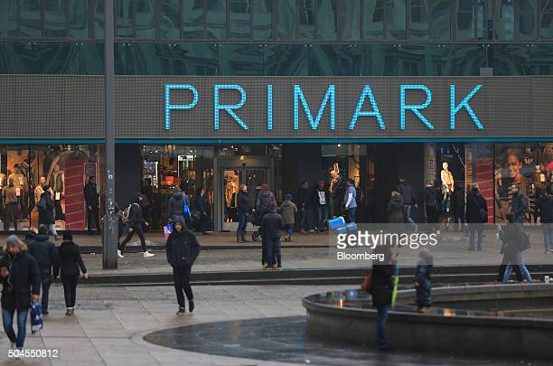 Pedestrians pass a Primark clothing fashion store operated by Associated British Foods Plc in Berlin Germany on Monday Jan 11 2016 With unemployment...