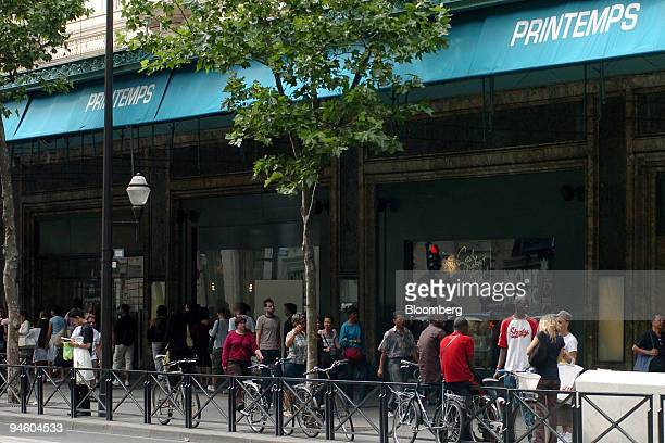 Pedestrians pass a Printemps store in Paris France Tuesday June 20 2006 PPR SA the French owner of Gucci Group NV is in exclusive talks to sell its...