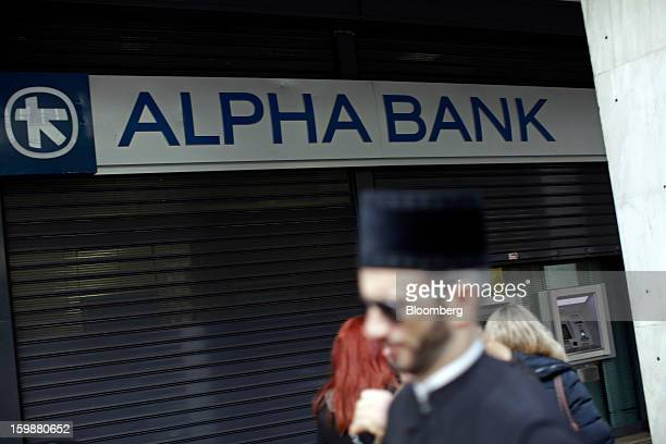 Pedestrians pass a shuttered branch of Alpha Bank AE in Athens Greece on Tuesday Jan 22 2013 Euroarea finance ministers blessed the next disbursement...