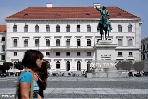 Pedestrians pass a statue of Maximilian of Bavaria in front of the Siemens AG headquarters in Munich Germany on Tuesday Aug 18 2009 Siemens AG is...