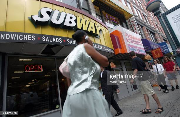 Pedestrians pass a Subway and a Dunkin' Donuts restaurant July 12 2006 in the Brooklyn borough of New York City In the battle to fight obesity New...