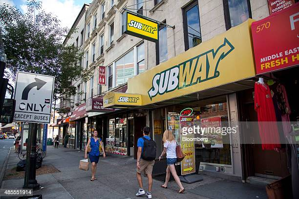 Pedestrians pass a Subway Restaurants location in the Brooklyn borough of New York, U.S., on Thursday, Aug. 27, 2015. After years of explosive growth...