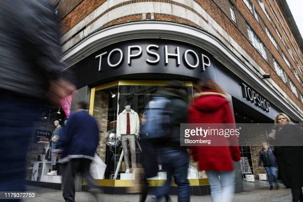 Pedestrians pass a Topshop fashion store, operated by Arcadia Group Ltd., on Oxford Street in London, U.K, on Thursday, Oct. 31, 2019. In the lead-up...