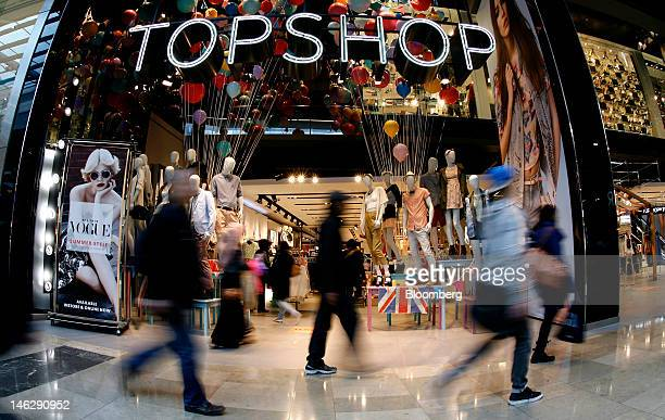Pedestrians pass a Topshop store at the Westfield Stratford City mall operated by Westfield Group in London UK on Tuesday June 12 2012 London...