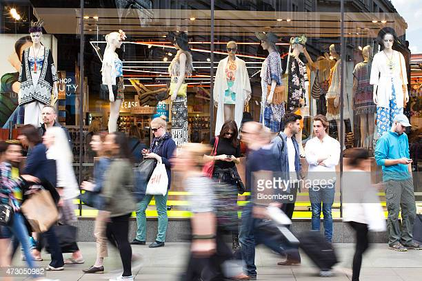 Pedestrians pass a Topshop women's fashion clothing store owned by Arcadia Group Ltd in London UK on Tuesday May 12 2015 The euroarea economy...
