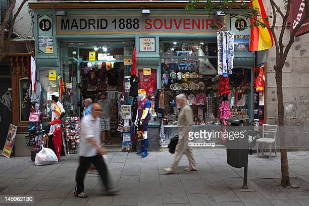 Pedestrians pass a tourist souvenir store in Madrid Spain on Friday June 8 2012 Spain is poised to become the fourth of the 17 euroarea countries to...
