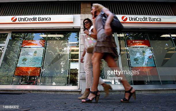 Pedestrians pass a UniCredit SpA bank branch in Rome, Italy, on Tuesday, July 17, 2012. UniCredit SpA and Intesa Sanpaolo SpA were among 13 Italian...