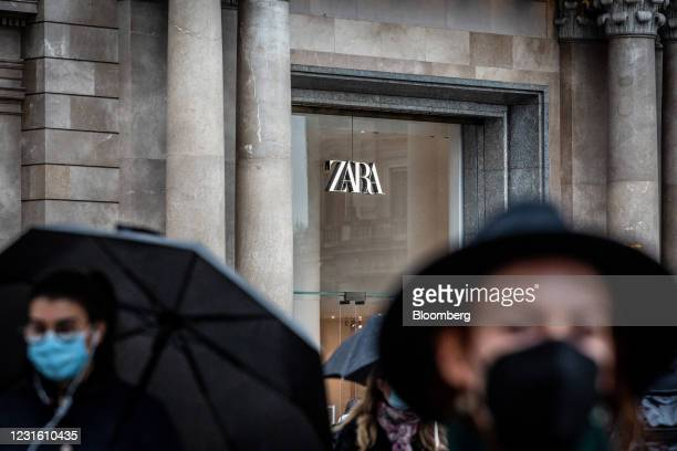 Pedestrians pass a Zara clothing store, operated by Inditex SA, in Barcelona, Spain, on Monday, March 8, 2021. Inditex will report its annual results...