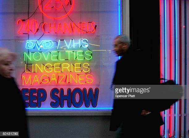 Pedestrians pass an adult store in Times Square March 15 2005 in New York City Sexrelated shops have started to make a comeback in Times Square ten...