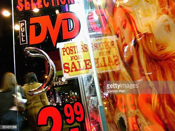 Pedestrians pass an adult video store in Times Square March 15 2005 in New York City Sexrelated shops have started to make a comeback in Times Square...
