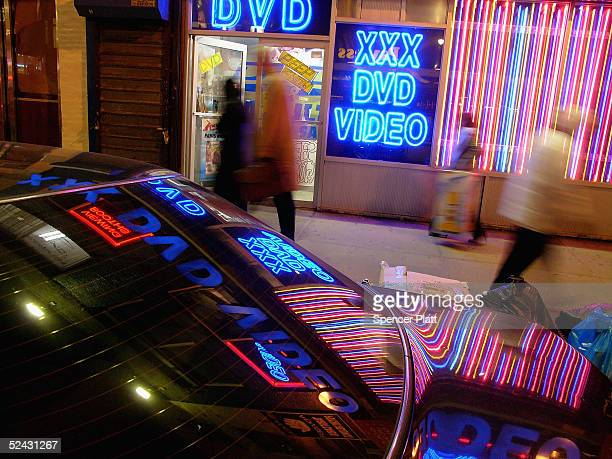 Pedestrians pass an adult video store in Times Squre March 15 2005 in New York City Sexrelated shops have started to make a comeback in Times Square...