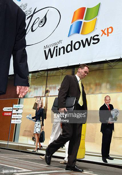 Pedestrians pass an advertisement for Microsoft Windows XP in Frankfurt Germany Thursday June 16 2005 Microsoft Corp the world's biggest software...