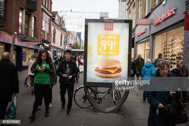 Pedestrians pass an advertisment for a fast food chain McDonald's as they make their way through Nottingham city centre in Nottingham central England...