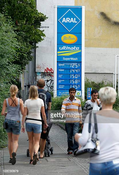 Pedestrians pass an Aral gas station owned by BP Plc in Berlin Germany on Wednesday Aug 4 2010 BP Plc has no plans to sell its German gasoline...