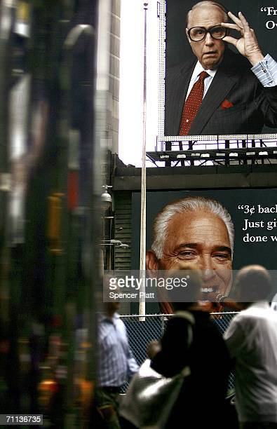 Pedestrians pass billboards in Times Square June 6 2006 in New York City According to the Bible's Book of Revelation 666 is the mark of the beast...