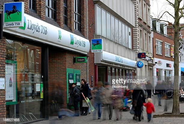 Pedestrians pass branches of a Lloyds TSB bank part of the Lloyds Banking Group Plc a Barclays Plc bank a NatWest bank part of the Royal Bank of...