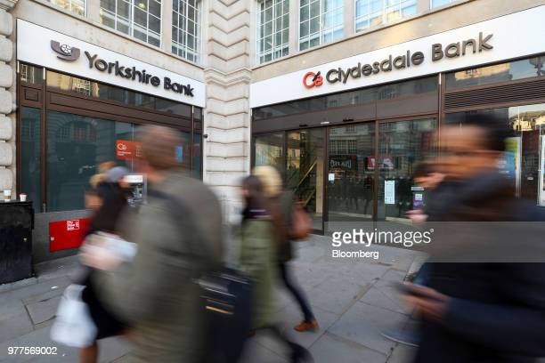 Pedestrians pass branches of Clydesdale Bank Plc and Yorkshire Bank Plc owned and operated by National Australia Bank Ltd in London UK on Tuesday Jan...