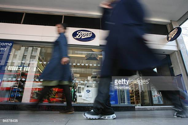 Pedestrians pass by a Boots pharmacy in London UK Tuesday March 27 2007
