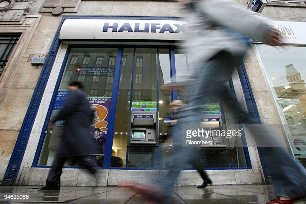 Pedestrians pass by a branch of the Halifax Bank part of the HBOS Plc group in London Tuesday Feb 27 2007 Stocks in Europe and Asia advanced led by...