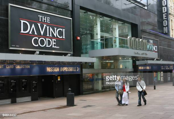Pedestrians pass by a Da Vinci Code movie billboard outside the Odeon Theater in London's Leicester Square Wednesday May 17 2006 The Da Vinci Code...
