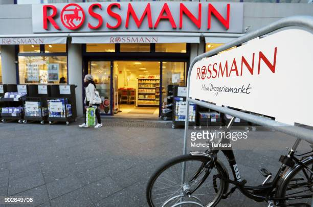 Pedestrians pass by a Rossmann drogerie Store on January 8 2018 in Berlin Germany According to government statisticians nominal revenue grew compared...