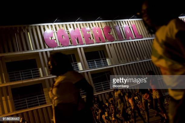 Pedestrians pass by a shopping mall at night in Bissau GuineaBissau on Sunday Feb 11 2018 The International Monetary Fund said an increase in public...