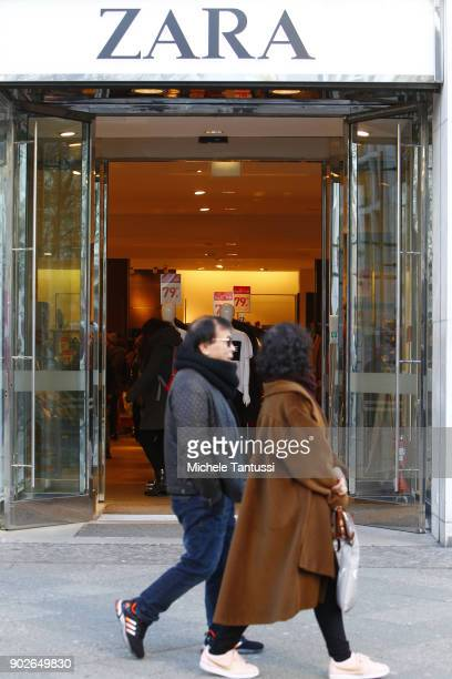 Pedestrians pass by a ZARA Textiles shop on January 8 2018 in Berlin Germany According to government statisticians nominal revenue grew compared to...