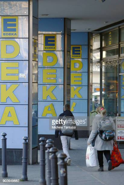 Pedestrians pass by an EDEKA supermarket on January 8 2018 in Berlin Germany According to government statisticians nominal revenue grew compared to...