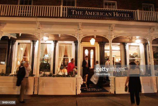 Pedestrians pass by the American Hotel in Sag Harbor New York on Aug 18 2007 As the Dow Jones Industrial Average dropped as much as 12 percent from...
