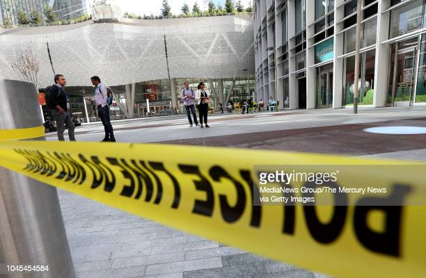 Pedestrians pass by the closed Salesforce Transit Center in San Francisco Calif on Wednesday Sept 26 2018 The center was closed yesterday after...