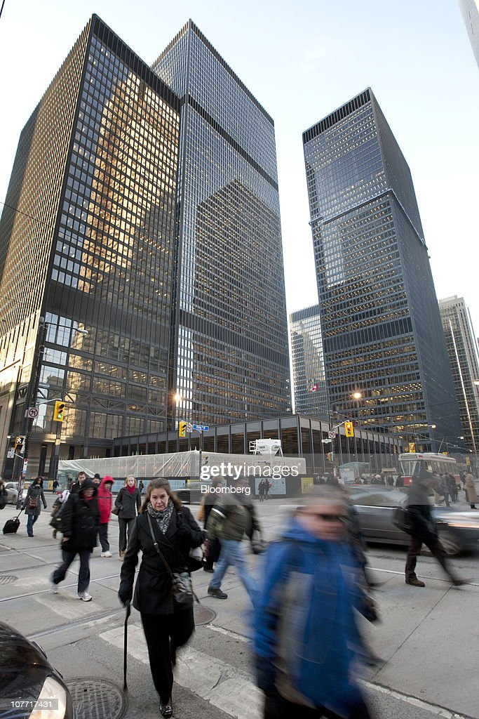 Pedestrians pass by the headquarters building of Toronto-Dominion Bank (TD) in Toronto, Ontario, Canada, on Tuesday, Dec. 21, 2010. Toronto-Dominion Bank agreed to buy Chrysler Financial Corp. from Cerberus Capital Management LP for $6.3 billion in cash, adding an auto-finance company in its second-largest acquisition. Photographer: Norm Betts/Bloomberg via Getty Images