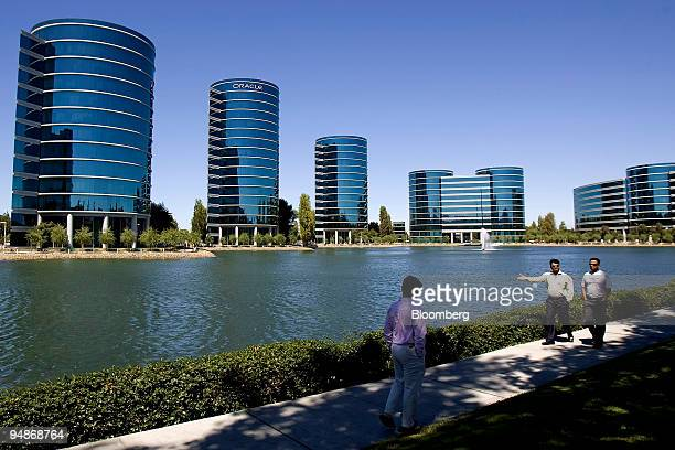 Pedestrians pass by the headquarters campus of Oracle Corp. In Redwood City, California, U.S., on Wednesday, July 30, 2008. Oracle Corp. Chief...