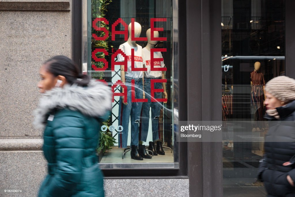 Pedestrians pass in front of a Bershka Magyaroszag Kft store in the SoHo neighborhood of New York, U.S., on Friday, Feb. 9, 2018. Bloomberg is scheduled to release consumer comfort figures on February 15. Photographer: Sarah Blesener/Bloomberg via Getty Images