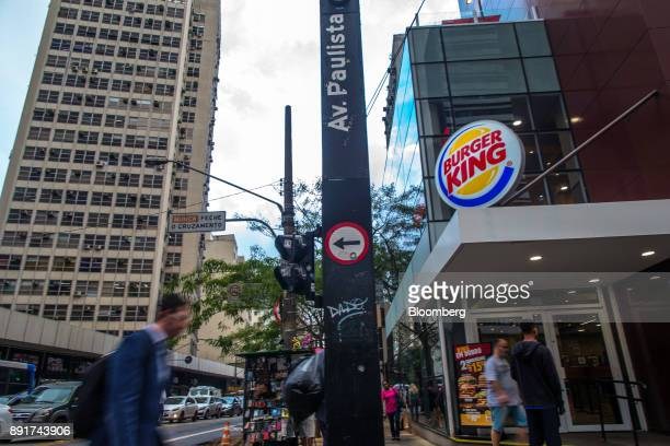 Pedestrians pass in front of a Burger King do Brasil restaurant on Paulista Avenue in Sao Paulo Brazil on Monday Dec 11 2017 Burger King do Brasil...