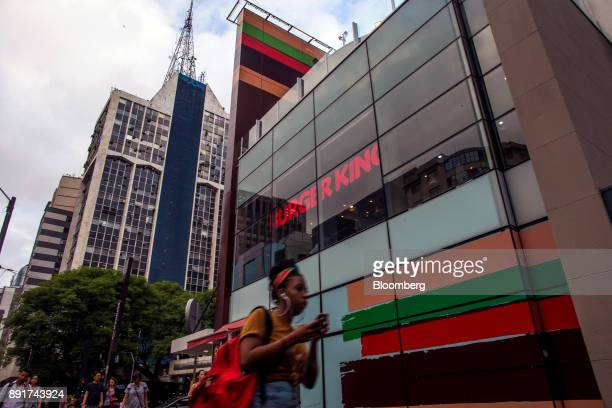 Pedestrians pass in front of a Burger King do Brasil restaurant on Paulista Avenue in Sao Paulo, Brazil, on Monday, Dec. 11, 2017. Burger King do...