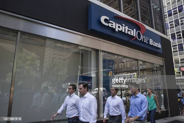 Signage is displayed inside the window of a Capital One Financial Corp bank branch in New York US on Wednesday July 19 2018 Capital One Financial...
