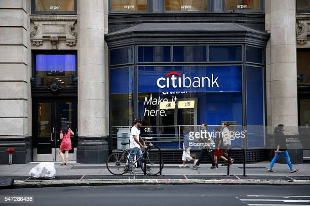 Pedestrians pass in front of a Citigroup Inc bank branch in New York US on Tuesday July 12 2016 Citigroup Inc is scheduled to report quarterly...