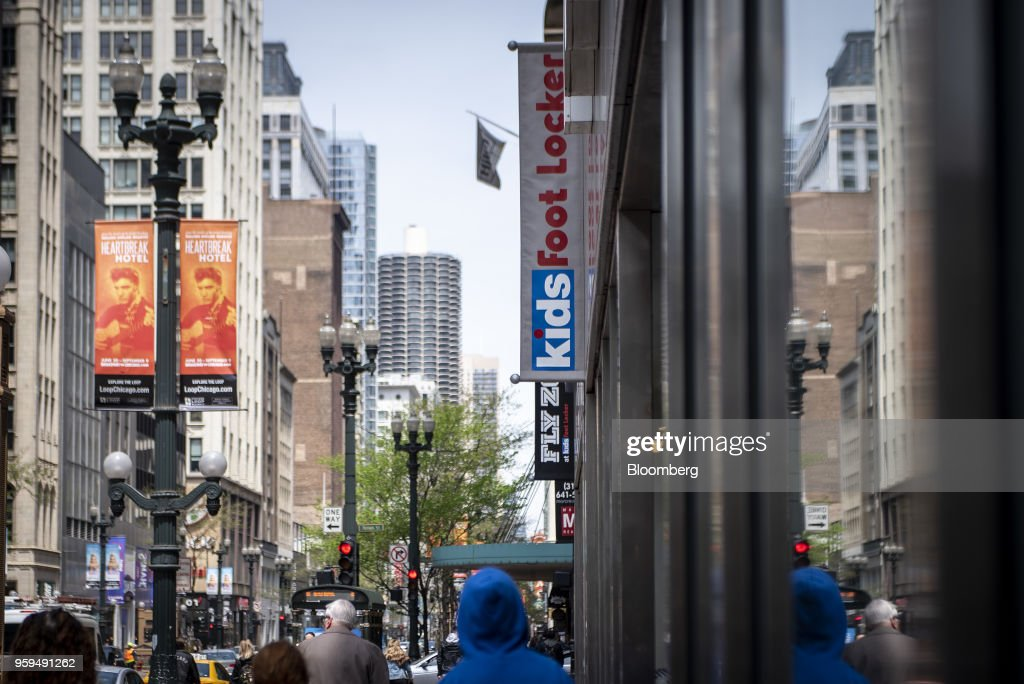 Pedestrians pass in front of a Foot Locker Inc. store in downtown Chicago, Illinois, U.S., on Sunday, May 13, 2018. Foot Locker Inc. is scheduled to release earnings figures on May 25. Photographer: Christopher Dilts/Bloomberg via Getty Images