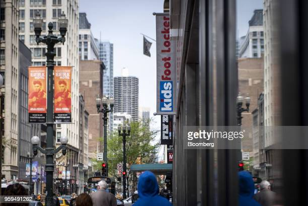 Pedestrians pass in front of a Foot Locker Inc store in downtown Chicago Illinois US on Sunday May 13 2018 Foot Locker Inc is scheduled to release...