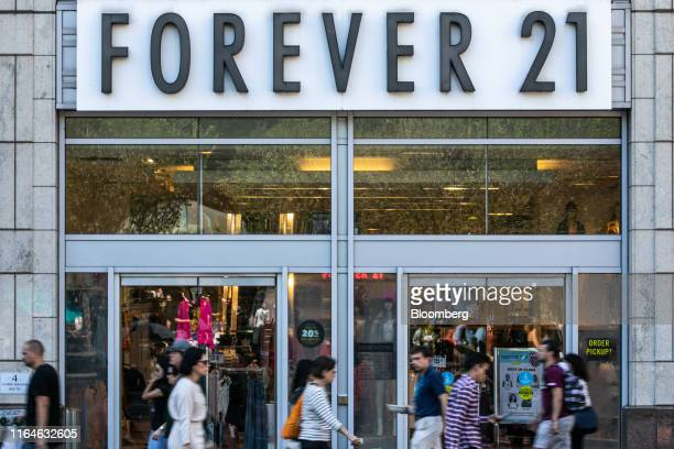 Pedestrians pass in front of a Forever 21 Inc. Store in the Union Square neighborhood of New York, U.S., on Thursday, Aug. 29, 2019. Forever 21 Inc....