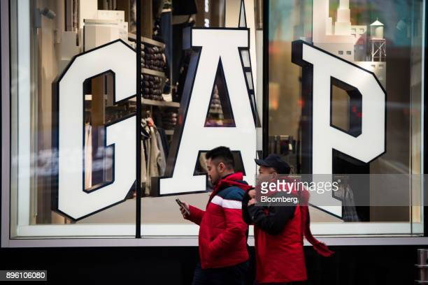a41a6673caf Pedestrians pass in front of a Gap Inc store in New York US on Wednesday Dec