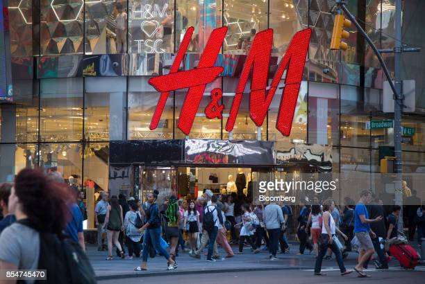 Pedestrians pass in front of a Hennes Mauritz AB store in New York US on Saturday Sept 23 2017 Hennes Mauritz AB is scheduled to release earnings...