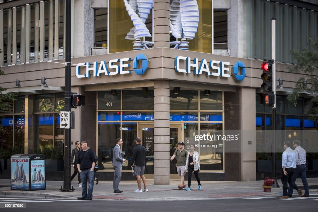 pedestrians pass in front of a jpmorgan chase bank branch in