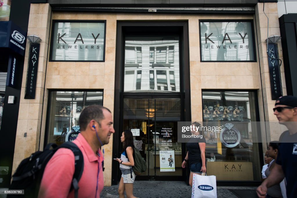 Pedestrians pass in front of a Kay Jewelers store, a subsidiary of Signet Jewelers Ltd., in New York, U.S., on Wednesday, Aug. 23, 2017. Signet Jewelers Ltd. is scheduled to release earnings figures on August 24. Photographer: Mark Kauzlarich/Bloomberg via Getty Images