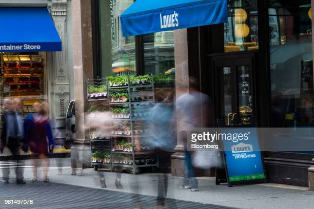 Pedestrians pass in front of a Lowe's Cos store in New York US on Tuesday May 22 2018 Lowe's Cos is scheduled to release earnings figures on May 23...
