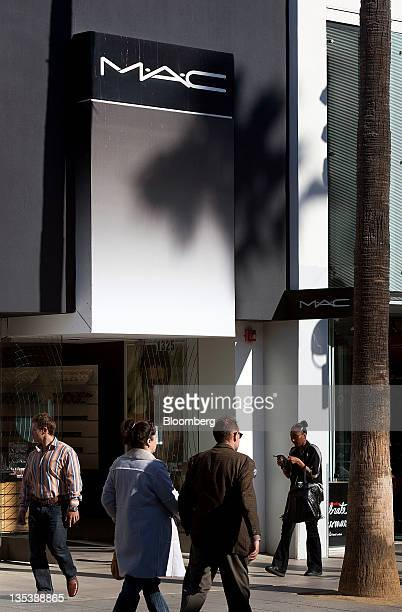 Pedestrians pass in front of a MAC Cosmetics store at the Third Street Promenade outdoor mall in Santa Monica California US on Monday Dec 5 2011...